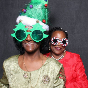 two SAFE Easy Street Club members wearing Christmas photo props