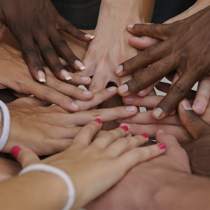 all different peoples hands in a pile