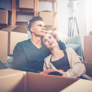 Couple relaxing after moving in to their new home.