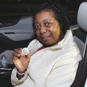 Shirley Magazine-Ward holding sitting in her new vehicle