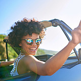 woman wearing sunglasses in convertible