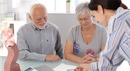 Older couple looking at a document with their financial advisor